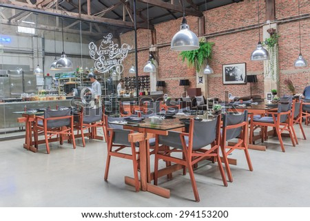 BANGKOK - JULY,7: The modern Bangkok's restaurant with open kitchen where is decorated by wood and classic style. We can see chef cooking meal.THAILAND JULY,7 2015