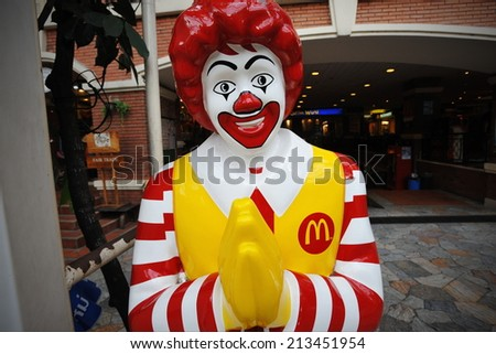 BANGKOK - JULY 11: View of Ronald McDonald in front of a McDonald's outlet in the city centre on July 11, 2013 in Bangkok, Thailand. McDonald's operates in 119 countries with 160 stores in Thailand. - stock photo