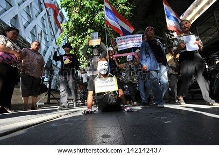 BANGKOK - JUN 9: A disabled protester wearing a Guy Fawkes mask leads an anti-government rally through Bangkok's shopping district on Jun 9, 2013 in Bangkok, Thailand.