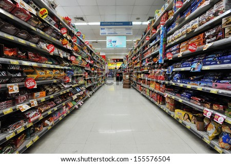 BANGKOK - JUN 15: A view of an empty aisle at a Tops Supermarket on Jun 15, 2013 in Bangkok, Thailand. Tops is the largest supermarket chain in Thailand operating around 120 stores nationwide. - stock photo