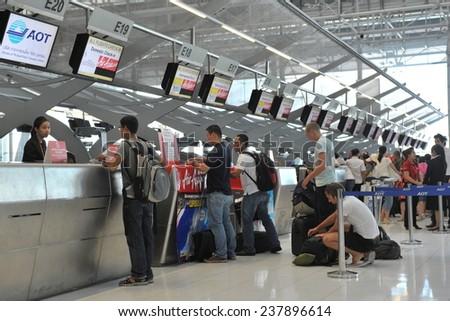 BANGKOK - JUN 28: Air travelers check in for flights at counters of Suvarnabhumi International Airport on Jun 28, 2012 in Bangkok, Thailand. The  airport handles 45 million passengers annually. - stock photo