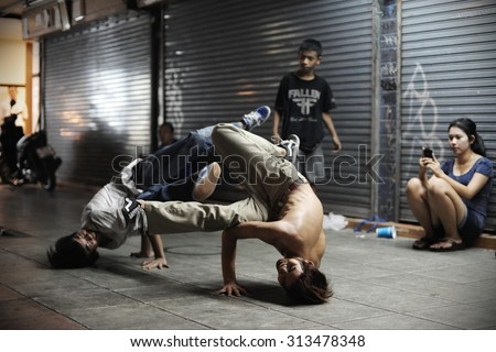 BANGKOK - JUN 3: B-boys breakdance at an informal street dance meet on Jun 3, 2012 in Bangkok, Thailand. Breakdancing is a popular activity with youth in the Thai capital.