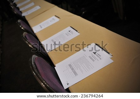 BANGKOK - JUN 22: Exam papers sit on tables before an academic competition held between schools in the southeast Asia region on Jun 22, 2012 in Bangkok, Thailand. - stock photo