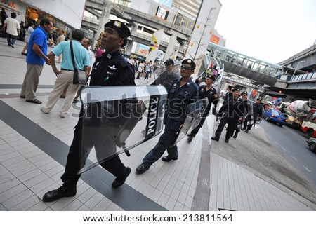 BANGKOK - JUN 9: Riot police deploy on a city centre street following anti government protests on Jun 9, 2013 in Bangkok, Thailand. Protesters call for the government to be overthrown. - stock photo