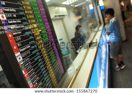 BANGKOK - JUN 1: Tourist exchange rate display at a streetside booth as the Thai Baht falls for 7th week on Jun 1, 2013 in Bangkok, Thailand. The Baht has fallen rapidly as foreign investors cash out. - stock photo