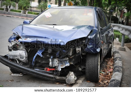 BANGKOK - JUNE 5: A crashed car sits by a roadside on June 5, 2013 in Bangkok, Thailand. According to Dept of Land Transport statistics Bangkok saw 27166 road vehicle accidents between 2011 and 2012.