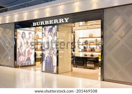 BANGKOK - JUNE 17: Burberry Store in Suvarnabhumi Airport, Bangkok on Jun 17, 2014. It is a British luxury fashion house, distributing clothing, fashion accessories, fragrances and cosmetics. - stock photo
