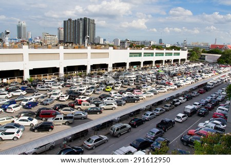 BANGKOK- JUNE  28 :Cars parked at a park and side lot at a BTS station in Chatuchak district on June 28,2015 in Bangkok,Thailand.The government has promoted park and ride to reduce traffic congestion. - stock photo