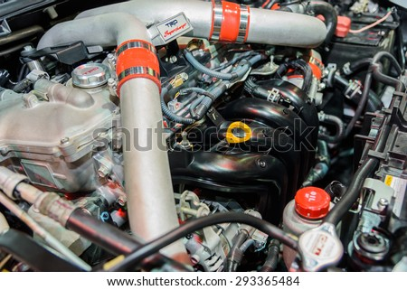 BANGKOK - JUNE 24 : Engine of Toyota TRD Super Charger on display at Bangkok International Auto Salon 2015 on June 24, 2015 in Bangkok, Thailand. Event of decoration and modify car.