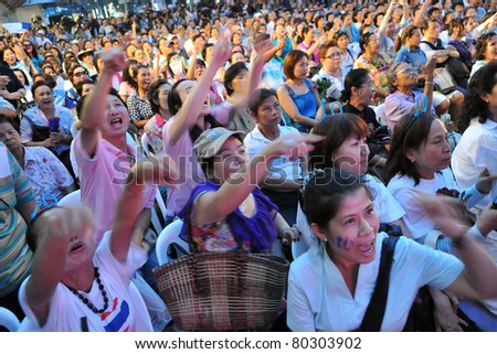 BANGKOK - JUNE 23: Supporters of the Thai Democrat Party attend an election campaign rally at Ratchaprasong in the city centre June 23, 2011 in Bangkok, Thailand. Thais go to the polls on July 3.