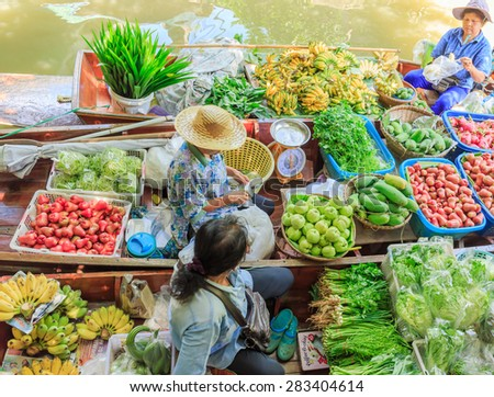 "BANGKOK - JUNE,2 : The boats are full of fruits and vegetables that seller are join at floating market named "" KLONG LAD MA YOM "" .There are many tourist visiting here everyday. THAILAND JUNE,2 2015"