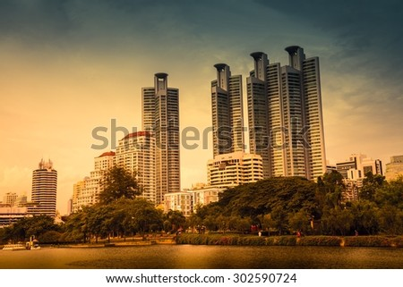 Bangkok lake cityscape skyline in beautiful evening light - stock photo