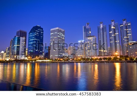 Bangkok Lake with modern building at twilight