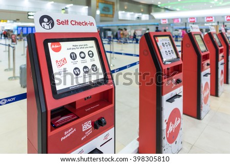 BANGKOK - MAR 29: Air Asia self check-in service counter at Don Mueang International Airport on March 29, 2016 in Bangkok,Thailand. Air Asia has been the world's best low-cost airline  - stock photo