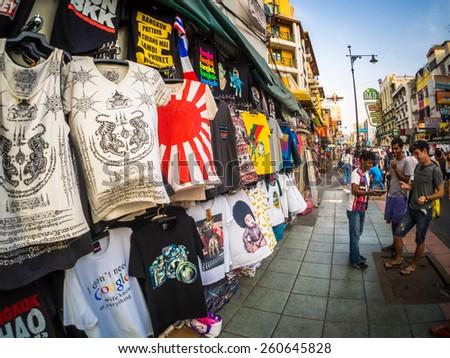 BANGKOK - MAR 8: An unidentified street vendor prepares sell Clothing to foreign traveler on Khao San Road on Mar 8, 2015 in Bangkok, Thailand. - stock photo