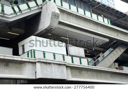 BANGKOK - MAR 29: BTS Skytrain on elevated rails in Asoke district on Mar 29,2015 in Bangkok. It's the fist electric train system in thailand. Each train can carry over 1,000 passengers. - stock photo