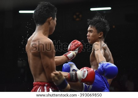 BANGKOK - MAR13: Desel Noi O.Sakao Rat (R)(Win) fights with Khunphon Noi Si Sam Ang in thai boxing competition - Battle Of Sor.Sommai d at Rajadamnern stadium on March 13, 2016 in Bangkok.
