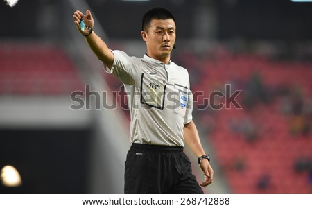 BANGKOK, MAR 27: FU MING Referee form China in action during AFC U-23 Championship 2016 (Qualifiers) between Thailand and Cambodia at Rajamangala stadium on March 27, 2015 in Bangkok, Thailand.  - stock photo