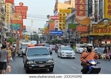 BANGKOK - MAR 2: General view of a busy city road in the old Chinatown district on Mar 2, 2012 in Bangkok, Thailand. Ethnic Chinese began settling in the Thai capital's Chinatown circa 1800s. - stock photo