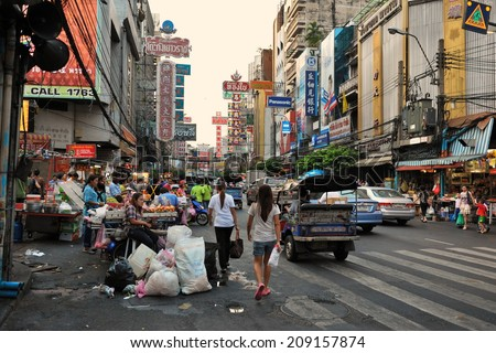 BANGKOK - MAR 2: General view of Yaowarat Road in Chinatown on Mar 2, 2012 in Bangkok, Thailand. Opened in 1891 during King Rama V's reign, Yaowarat is the main street in the Thai capital's Chinatown. - stock photo