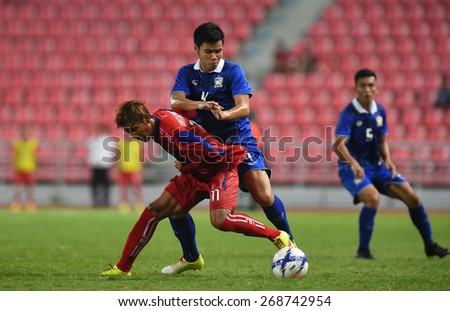 BANGKOK, MAR 27: K.SUWANNAPAT(B) of Thailand in action during AFC U-23 Championship 2016 (Qualifiers) between Thailand and Cambodia at Rajamangala stadium on March 27, 2015 in Bangkok, Thailand.  - stock photo