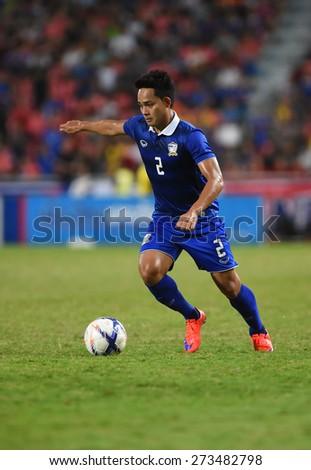 BANGKOK, MAR31:Perapat.N(B) of Thailand in action during AFC U-23 Championship 2016(Qualifiers) between Thailand and DPR Korea at Rajamangala stadium on March 31, 2015 in Bangkok, Thailand.  - stock photo