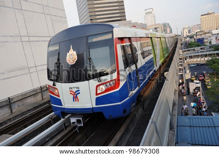 BANGKOK - MARCH 18: A BTS Skytrain on elevated rails above Sukhumvit Road on March 18, 2012 in Bangkok, Thailand. Each train of the mass transport rail network can carry over 1,000 passengers.