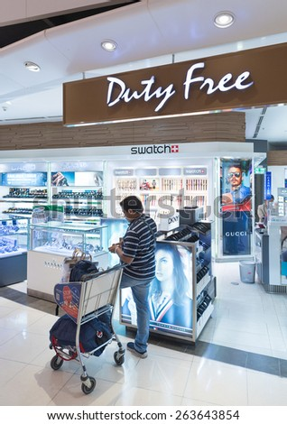 BANGKOK - MARCH 18; 2015: An unidentified man shops at a duty free watches shop at the International Airport Suvarnabhumi which is the sixth busiest airport in Asia. - stock photo