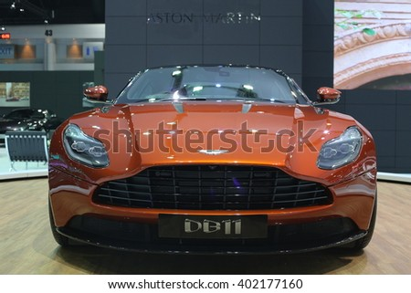 Bangkok - March 31 : Aston martin Spectre 007 DB11 on Orange car at The 37th Bangkok International Thailand Motor Show 2016 on March 31, 2016 in Bangkok, Thailand - stock photo