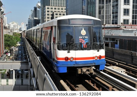 BANGKOK - MARCH 31: BTS Skytrain on elevated rails in the city centre on March 31, 2013 in Bangkok, Thailand. Each train of the mass transport rail network can carry over 1,000 passengers. - stock photo