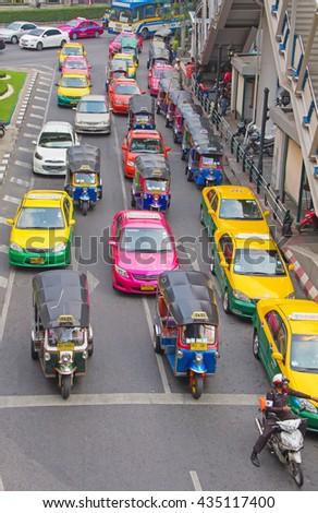 BANGKOK - MARCH 3: Daily traffic jam in the afternoon on March 3, 2012 in Bangkok, Thailand. Traffic jams remains constant problem in Bangkok despite rapid development of public transportation system. - stock photo