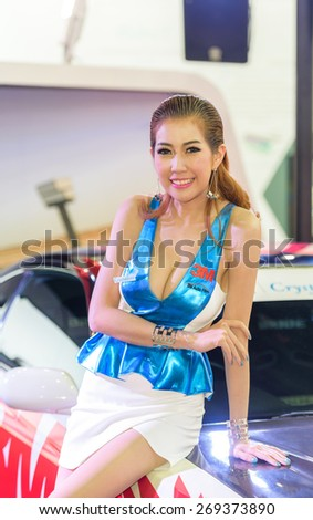 "BANGKOK - MARCH 24 : Female presenters model with 3M on display at The 36th Bangkok International Motor Show ""Art of Auto"" on March 24, 2015 in Bangkok, Thailand. - stock photo"