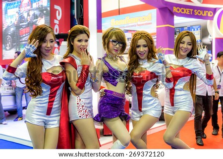 "BANGKOK - MARCH 24 : Female presenters model with Pioneer Rocket sound on display at The 36th Bangkok International Motor Show ""Art of Auto"" on March 24, 2015 in Bangkok, Thailand. - stock photo"