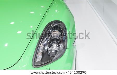Bangkok - March 22 : headlight of green Porsche super sport car- in display at The 37th Bangkok international Motor Show 2016 on March 22, 2016 in Bangkok Thailand - stock photo