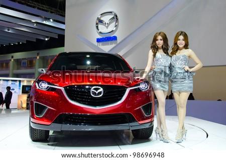 BANGKOK - MARCH 27: Mazda car with unidentified model on display at The 33th Bangkok International Motor Show  on March 27, 2012 in Bangkok, Thailand. - stock photo