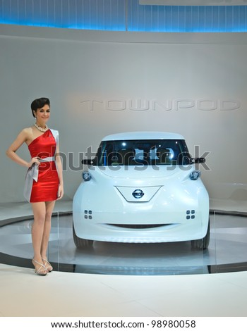 BANGKOK - MARCH 30: Nissan Zero emission car with unidentified model on display at The 33th Bangkok International Motor Show on March 30, 2012 in Bangkok, Thailand. - stock photo