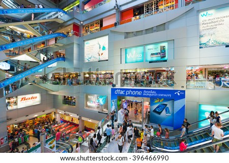 BANGKOK - MARCH 16, 2016: People walk inside the MBK Center, a large shopping mall that was the largest one in Asia when it opened in 1985.  - stock photo