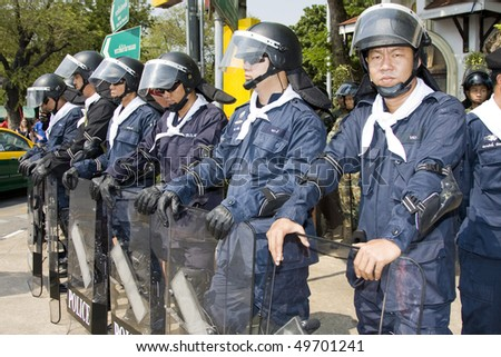 BANGKOK - MARCH 13: Policemen protect government buildings during anti government Solidarity demonstration on March 13, 2010 in Bangkok, Thailand.