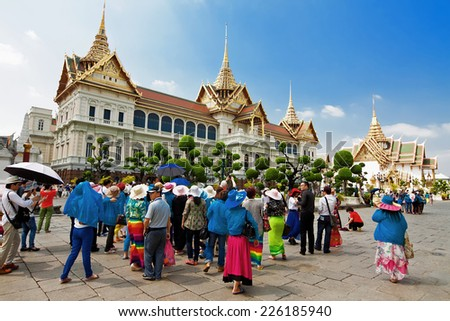 BANGKOK - MARCH 3: Tourists on excursion near Grand Palace in Bangkok, Thailand, March 3, 2014 Construction of palace began in 1782 by King Rama 1