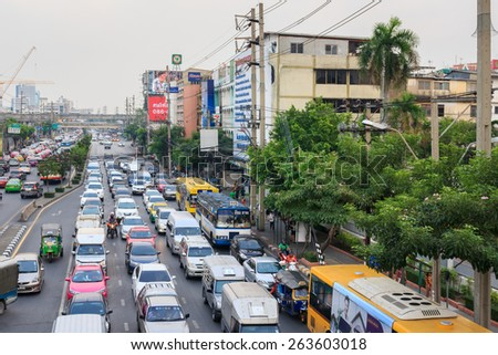 Bangkok - March 25: Traffic moves slowly along a busy road on March 25, 2015 in Bangkok, Thailand. Annually an estimated 150,000 new cars join the already heavily congested streets of Bangkok. - stock photo