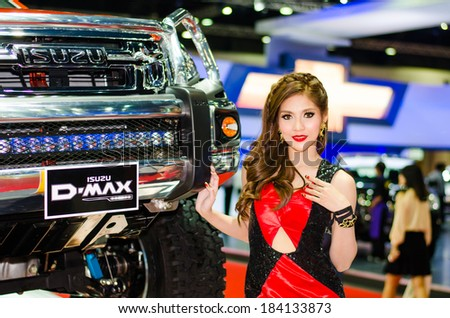 BANGKOK - MARCH 25: Unidentified model with Isuzu D-Max on display at The 35th Bangkok International Motor Show on March 25, 2014 in Bangkok, Thailand.
