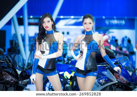 BANGKOK - March 24, 2015 : Unidentified model with Yamaha Motorcycle  on display at The 36th Bangkok International Motor show on March 24, 2015 in Bangkok, Thailand.  - stock photo