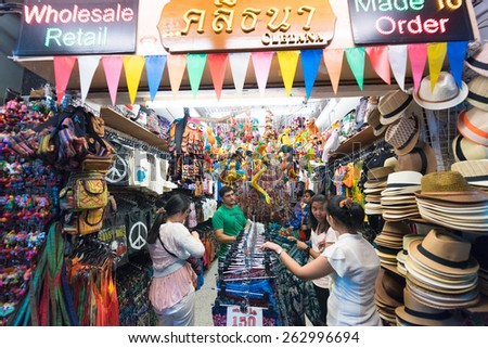 BANGKOK - MARCH 9, 2015: Unidentified people buy at a souvenir shop in Khao San Road Street. It is called the heart of backpackers universe. - stock photo