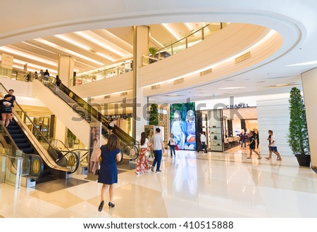 BANGKOK - MARCH 17, 2016 : Unidentified people walk inside the Siam Paragon Shopping mall. It is one of the biggest shopping centres in Asia. - stock photo