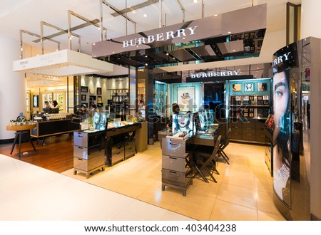 BANGKOK - MARCH 17, 2016 : Unidentified sellers work at a Burberry store the Siam Paragon Shopping mall. Burberry, a British luxury fashion house, has more than 500 stores in over 50 countries.