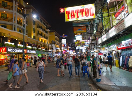 BANGKOK - MARCH 9, 2015: Unidentified tourists walk along Khao San Road Street. It is lined up with budget hotels and restaurants and is called the heart of backpackers universe. - stock photo