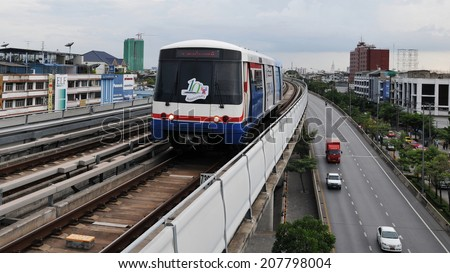 BANGKOK - MAY 29: A BTS Skytrain runs through the city centre on May 29, 2010 in Bangkok, Thailand. The Thai capital's BTS mass public transport rail network carries 600,000 passengers daily. - stock photo