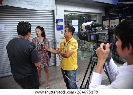 BANGKOK - MAY 27: A bystander gives an interview to news media after a nail bomb blast on May 27, 2013 in Bangkok, Thailand. The bomb injured 7 people, while police unclear of a motive or suspects. - stock photo
