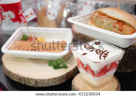 """BANGKOK - MAY 1, 2016 : Food and Dessert from Character Cafe in Thailand """"Bloody Bunny Cafe"""", Bitec Bangna. Selective focus on Bloody Bunny Strawberry Short Cake. Shallow Depth of field. Blur Hot Dog. - stock photo"""