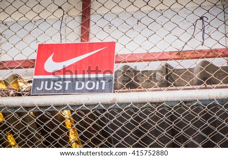 "BANGKOK - MAY 3 : ""JUST DO IT"" Nike logo printed on old wood label. Nike one of famous sport fashion brand worldwide on May 3, 2016 in Bangkok, Thailand."